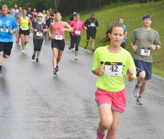 "<div class=""source"">Calen McKinney</div><div class=""image-desc"">Runners take off in the rain.</div><div class=""buy-pic""><a href=""http://web2.lcni5.com/cgi-bin/c2newbuyphoto.cgi?pub=085&orig=dam_runner_6.jpg"" target=""_new"">Buy this photo</a></div>"