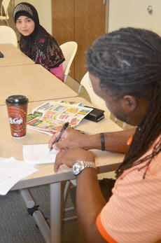 "<div class=""source"">Calen McKinney</div><div class=""image-desc"">Smith takes notes as Fatimah Alabusalim talks about her favorite character from ""The Fantastical Adventures of Sleepy Steve: Reuniting the Stone.""</div><div class=""buy-pic""><a href=""http://web2.lcni5.com/cgi-bin/c2newbuyphoto.cgi?pub=085&orig=deronte_smith_focus_group_6_color.jpg"" target=""_new"">Buy this photo</a></div>"