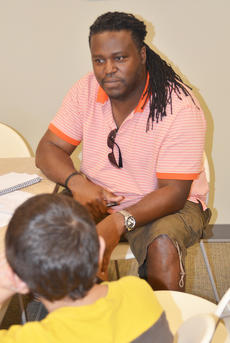 "<div class=""source"">Calen McKinney</div><div class=""image-desc"">Smith listens as the students critique ""The Fantastical Adventures of Sleepy Steve: Reuniting the Stone."" Pictured is student Hassan Alabusalim.</div><div class=""buy-pic""><a href=""http://web2.lcni5.com/cgi-bin/c2newbuyphoto.cgi?pub=085&orig=deronte_smith_focus_group_7_color.jpg"" target=""_new"">Buy this photo</a></div>"