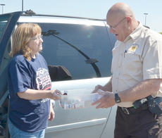 "<div class=""source"">Calen McKinney</div><div class=""image-desc"">Janice Corbin of Campbellsville gives Paul Lacy, a part-time security worker at the Taylor County Judicial Center, a container of her old medications.</div><div class=""buy-pic""><a href=""/photo_select/51340"">Buy this photo</a></div>"