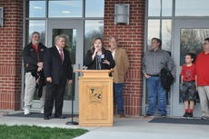 """<div class=""""source"""">ZAC OAKES/CKNJ</div><div class=""""image-desc"""">Taylor County Primary Center Principal Melissa Long speaks during the grand opening celebration for her school Thursday. Superintendent Roger Cook, left, and Taylor County Board of Education Chair Tony Davis, right, look on.</div><div class=""""buy-pic""""><a href=""""/photo_select/64923"""">Buy this photo</a></div>"""