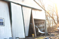 """<div class=""""source"""">Zac Oakes</div><div class=""""image-desc"""">Local farmer Rod Phillips sustained damage to his farm Saturday night due to an EF-1 tornado that touched down on Cave Road</div><div class=""""buy-pic""""><a href=""""/photo_select/66316"""">Buy this photo</a></div>"""