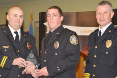 """<div class=""""source"""">Calen McKinney</div><div class=""""image-desc"""">Campbellsville Fire & Rescue special operations team member Aaron Fields receives this year's Rescuer of the Year Award from Campbellsville Fire & Rescue Chief Kyle Smith, at right, and Taylor County Fire & Rescue Chief George Wilson.  </div><div class=""""buy-pic""""><a href=""""http://web2.lcni5.com/cgi-bin/c2newbuyphoto.cgi?pub=085&orig=fire_rescue_awards-fields_web.jpg"""" target=""""_new"""">Buy this photo</a></div>"""
