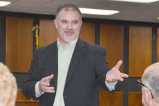"""<div class=""""source"""">Calen McKinney</div><div class=""""image-desc"""">State Rep. John """"Bam"""" Carney, R-Campbellsville, talks with residents at a forum he hosted with State Sen. Sara Beth Gregory, R-Monticello, on Monday.</div><div class=""""buy-pic""""><a href=""""/photo_select/49675"""">Buy this photo</a></div>"""
