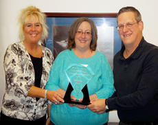 """<div class=""""source""""></div><div class=""""image-desc"""">Melinda Cox recently received the J.W. Duke Outstanding Achievement Award for her high degree of excellence in job performance, skills and her commitment to Frost Arnett Company's core values. Melinda has been with the company since 2011. James Thomas and Deborah Burris presented the award.</div><div class=""""buy-pic""""></div>"""