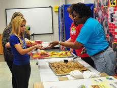 "<div class=""source"">Leslie Moore</div><div class=""image-desc"">Joyce Johnson, food services assistant, gives student Kayla Ford a homemade blueberry bar during Taylor County High School's Fuel Up to Play 60 grant kickoff.</div><div class=""buy-pic""><a href=""http://web2.lcni5.com/cgi-bin/c2newbuyphoto.cgi?pub=085&orig=fuel_up_grant_1_color.jpg"" target=""_new"">Buy this photo</a></div>"