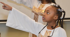 "<div class=""source"">Calen McKinney</div><div class=""image-desc"">Lavonya Caldwell dances with Pleasant Union Baptist Church's youth group Joyful Light. The group performed a liturgical dance to ""Take Me To The King"" by Tamela Mann to encourage people to know Jesus.</div><div class=""buy-pic""><a href=""http://web2.lcni5.com/cgi-bin/c2newbuyphoto.cgi?pub=085&orig=gcu_black_history_9.jpg"" target=""_new"">Buy this photo</a></div>"