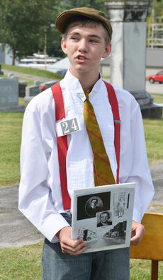 """<div class=""""source"""">Calen McKinney</div><div class=""""image-desc"""">Christian Berry portrays the spirit of the late Jodie Gozder, founder of the News-Journal in Campbellsville.</div><div class=""""buy-pic""""><a href=""""http://web2.lcni5.com/cgi-bin/c2newbuyphoto.cgi?pub=085&orig=ghost_tour_29.jpg"""" target=""""_new"""">Buy this photo</a></div>"""