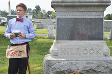 """<div class=""""source"""">Calen McKinney</div><div class=""""image-desc"""">The spirits of former mayors, bankers, lawyers, doctors, judges and other prominent residents were alive on Sunday. Brookside Cemetery and Hiestand House Museum-Taylor County Museum hosted the second annual Ghost Tour of Brookside Cemetery, with Campbellsville and Taylor County middle school students portraying 26 of the residents buried at the cemetery. The students dressed in period costumes and told the crowd about the life of the person they were representing. Money raised went toward the upkeep of the cemetery and the Hiestand House Museum. Above, Alex Doss, dressed as the late Joe Willock, explains to a crowd that Willock owned the first Coca-Cola bottling company in Campbellsville during the recent Ghost Tour at Brookside Cemetery.</div><div class=""""buy-pic""""><a href=""""http://web2.lcni5.com/cgi-bin/c2newbuyphoto.cgi?pub=085&orig=ghost_tour_5b.jpg"""" target=""""_new"""">Buy this photo</a></div>"""
