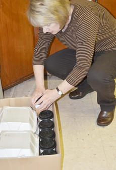 """<div class=""""source"""">Calen McKinney</div><div class=""""image-desc"""">Debbie Carter, vice chair of the GRM Board of Directors, packs to-go lunches.</div><div class=""""buy-pic""""><a href=""""/photo_select/50216"""">Buy this photo</a></div>"""