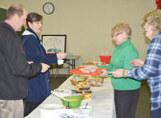 """<div class=""""source"""">Calen McKinney</div><div class=""""image-desc"""">Virgil and Jeanette Parker of Campbellsville, at left, are served soup during the lunch. At right are Shirley Cheatham, GRM's director, and Pam Tennant, a GRM volunteer.</div><div class=""""buy-pic""""><a href=""""/photo_select/50218"""">Buy this photo</a></div>"""