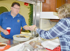 """<div class=""""source"""">Calen McKinney</div><div class=""""image-desc"""">GRM volunteer Pam Tennant, at right, serves soup to Allen Crabtree during Tuesday's lunch.</div><div class=""""buy-pic""""><a href=""""/photo_select/50219"""">Buy this photo</a></div>"""