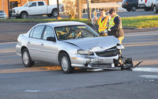 """<div class=""""source"""">Leslie Moore</div><div class=""""image-desc"""">A Campbellsville woman was involved in a two-vehicle injury crash on East Broadway on Monday afternoon.</div><div class=""""buy-pic""""></div>"""