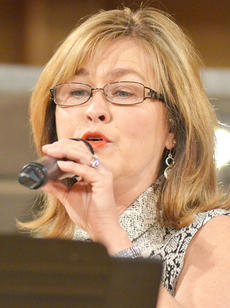 """<div class=""""source"""">Calen McKinney</div><div class=""""image-desc"""">Debbie Lawson of the new group Harvest performs at Hearts To Help, a fundraiser concert on Saturday to raise money for Green River Ministries.</div><div class=""""buy-pic""""><a href=""""/photo_select/48495"""">Buy this photo</a></div>"""