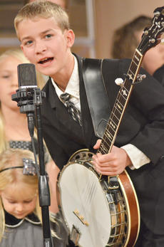 """<div class=""""source"""">Calen McKinney</div><div class=""""image-desc"""">Timothy Lindsey, 11, performs with his family, The Lindsey Family, of Greensburg, at Hearts To Help, a fundraiser concert on Saturday to raise money for Green River Ministries.</div><div class=""""buy-pic""""><a href=""""/photo_select/48501"""">Buy this photo</a></div>"""