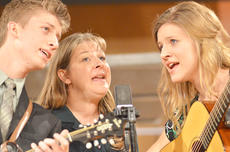 """<div class=""""source"""">Calen McKinney</div><div class=""""image-desc"""">From left, Caleb, Tammy and Rebekah Lindsey perform with their family, The Lindsey Family, of Greensburg, at Hearts To Help, a fundraiser concert on Saturday to raise money for Green River Ministries.</div><div class=""""buy-pic""""><a href=""""/photo_select/48503"""">Buy this photo</a></div>"""