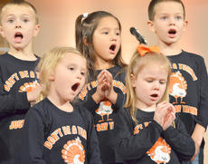 """<div class=""""source"""">Calen McKinney</div><div class=""""image-desc"""">Campbellsville Christian Church's Tiny Tunes Children's Choir performs at Hearts To Help, a fundraiser concert on Saturday to raise money for Green River Ministries. Front, from left, are Jenna Thompson and Lizzie Booe, and, in back, Keaton Hord, Amy Gilbrech and Grayson Booe.</div><div class=""""buy-pic""""><a href=""""/photo_select/48517"""">Buy this photo</a></div>"""