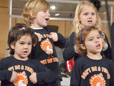 """<div class=""""source"""">Calen McKinney</div><div class=""""image-desc"""">Front, from left, Madison Nunn and Karsyn Smith and, in back, Kaysen Thompson and Peyton Godsey sing with Campbellsville Christian Church's Tiny Tunes Children's Choir at Hearts To Help, a fundraiser concert on Saturday to raise money for Green River Ministries.</div><div class=""""buy-pic""""><a href=""""/photo_select/48522"""">Buy this photo</a></div>"""
