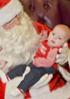 """<div class=""""source"""">Calen McKinney</div><div class=""""image-desc"""">Shelby Gwen Graham, 9 weeks old, of Campbellsville, poses for a photo with Santa. As her shirt reads, this will be her first Christmas.</div><div class=""""buy-pic""""><a href=""""http://web2.lcni5.com/cgi-bin/c2newbuyphoto.cgi?pub=085&orig=homemakers_bazaar_10.jpg"""" target=""""_new"""">Buy this photo</a></div>"""