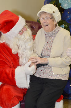 """<div class=""""source"""">Calen McKinney</div><div class=""""image-desc"""">Dorothy Kenneson, 94, of New York State, came to Campbellsville last weekend to visit family and had a chat with Santa. Since she has been good this year, she asked Santa for a trip to Florida.</div><div class=""""buy-pic""""><a href=""""http://web2.lcni5.com/cgi-bin/c2newbuyphoto.cgi?pub=085&orig=homemakers_bazaar_2.jpg"""" target=""""_new"""">Buy this photo</a></div>"""