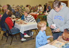 """<div class=""""source"""">Calen McKinney</div><div class=""""image-desc"""">Children and adults alike browse items for sale made by local homemakers.</div><div class=""""buy-pic""""><a href=""""http://web2.lcni5.com/cgi-bin/c2newbuyphoto.cgi?pub=085&orig=homemakers_bazaar_3.jpg"""" target=""""_new"""">Buy this photo</a></div>"""
