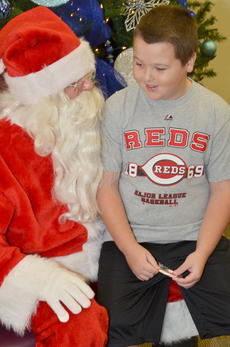 """<div class=""""source"""">Calen McKinney</div><div class=""""image-desc"""">Jack Sabo, 9, of Campbellsville, thinks about what he will ask Santa to bring him this Christmas.</div><div class=""""buy-pic""""><a href=""""http://web2.lcni5.com/cgi-bin/c2newbuyphoto.cgi?pub=085&orig=homemakers_bazaar_6.jpg"""" target=""""_new"""">Buy this photo</a></div>"""