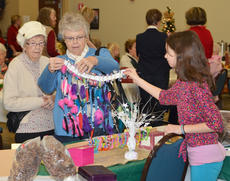 """<div class=""""source"""">Calen McKinney</div><div class=""""image-desc"""">Raven Adams, a member of the new Junior Homemaker Club at Taylor County Middle School, shows shoppers some of her creations.</div><div class=""""buy-pic""""><a href=""""http://web2.lcni5.com/cgi-bin/c2newbuyphoto.cgi?pub=085&orig=homemakers_bazaar_9.jpg"""" target=""""_new"""">Buy this photo</a></div>"""