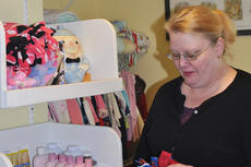 "<div class=""source"">Calen McKinney</div><div class=""image-desc"">Hope Pregnancy Center of Taylor County Director Marcia Gilbert folds a blanket donated to the Hope closet that provides essential baby items to parents in need.</div><div class=""buy-pic""><a href=""/photo_select/50011"">Buy this photo</a></div>"