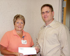 """<div class=""""source""""></div><div class=""""image-desc"""">Brian Spencer is pictured presenting a check to Jane Wheatley, TRH CEO.</div><div class=""""buy-pic""""><a href=""""/photo_select/10595"""">Buy this photo</a></div>"""