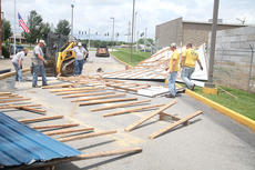 "<div class=""source"">Jeff Moreland</div><div class=""image-desc"">The roof was blown off a building near the Campbellsville Post Office Saturday evening. The building is located near storage facilities on Broadway, but according to Bobby Phillips, the building's owner, no property in the storage facility was damaged.</div><div class=""buy-pic""></div>"
