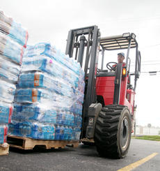 "<div class=""source"">Jeff Moreland</div><div class=""image-desc"">An employee of Lowe's delivers pallets of water to the parking lot of the Taylor County Extension Office Sunday afternoon. American Red Cross volunteers were on hand there to distribute the water to residents in need. Each family was allowed to receive one case of water, according to Bill Hagran with the American Red Cross.</div><div class=""buy-pic""></div>"