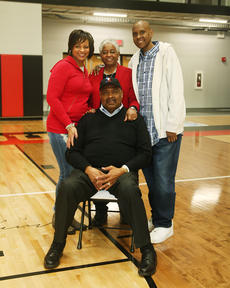 "<div class=""source"">Jeff Moreland</div><div class=""image-desc"">Clem Haskins is surrounded by his family, from left, including his daughter Lori Crook, his wife, Yevette, and his son, Brent. His other daughter, Clemette, could not attend due to a scheduling conflict. She is an ordained minister at a church in California, and was attending a retreat with the church.</div><div class=""buy-pic""><a href=""/photo_select/66532"">Buy this photo</a></div>"