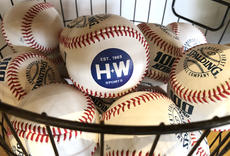 "<div class=""source"">Jeff Moreland</div><div class=""image-desc"">A bucket of baseballs display the new H+W logo</div><div class=""buy-pic""><a href=""/photo_select/66682"">Buy this photo</a></div>"