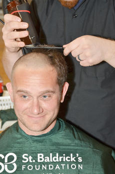"<div class=""source"">Calen McKinney</div><div class=""image-desc"">Keith Bricken smiles as his head is shaved.</div><div class=""buy-pic""><a href=""/photo_select/50829"">Buy this photo</a></div>"