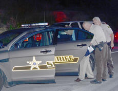 """<div class=""""source"""">Calen McKinney</div><div class=""""image-desc"""">Taylor County Sheriff's deputies are investigating a two-crash crash that happened just before 9 p.m. Saturday night at the intersection of KY 210 and Moss Road. An Elizabethtown man has been arrested and charged with DUI.</div><div class=""""buy-pic""""><a href=""""/photo_select/52439"""">Buy this photo</a></div>"""