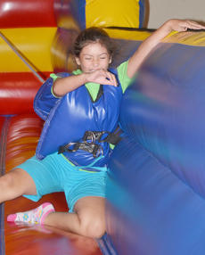 "<div class=""source"">Calen McKinney</div><div class=""image-desc"">Adrianna Celis, 9 1/2, of Campbellsville, laughs as she plays a game in a bounce house.</div><div class=""buy-pic""><a href=""http://web2.lcni5.com/cgi-bin/c2newbuyphoto.cgi?pub=085&orig=library_kid-wise_1.jpg"" target=""_new"">Buy this photo</a></div>"