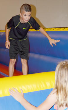 "<div class=""source"">Calen McKinney</div><div class=""image-desc"">Noah Rogers, 11, and Hannah Hansford, 8, both of Campbellsville, play tag in a bounce house.</div><div class=""buy-pic""><a href=""http://web2.lcni5.com/cgi-bin/c2newbuyphoto.cgi?pub=085&orig=library_kid-wise_2.jpg"" target=""_new"">Buy this photo</a></div>"