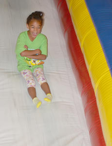 "<div class=""source"">Calen McKinney</div><div class=""image-desc"">De'Asia Fisher, 5, of Campbellsville, laughs as she makes her way down an inflatable slide.</div><div class=""buy-pic""><a href=""http://web2.lcni5.com/cgi-bin/c2newbuyphoto.cgi?pub=085&orig=library_kid-wise_4.jpg"" target=""_new"">Buy this photo</a></div>"