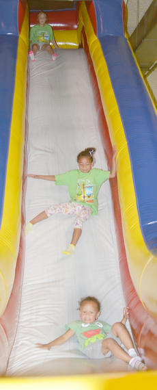 "<div class=""source"">Calen McKinney</div><div class=""image-desc"">From top, Harley Allen, 7, De'Asia Fisher, 5, and Elyzabeth Fisher, 3, all of Campbellsville, slide down an inflatable slide.</div><div class=""buy-pic""><a href=""http://web2.lcni5.com/cgi-bin/c2newbuyphoto.cgi?pub=085&orig=library_kid-wise_5.jpg"" target=""_new"">Buy this photo</a></div>"