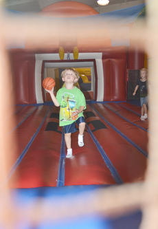 "<div class=""source"">Calen McKinney</div><div class=""image-desc"">Caleb Sprowles, 3, of Campbellsville shoots for the basket in a bounce house.</div><div class=""buy-pic""><a href=""http://web2.lcni5.com/cgi-bin/c2newbuyphoto.cgi?pub=085&orig=library_kid-wise_6.jpg"" target=""_new"">Buy this photo</a></div>"