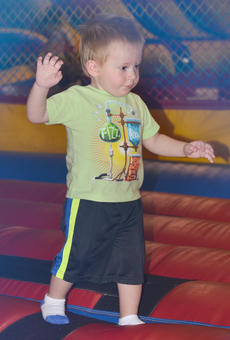 "<div class=""source"">Calen McKinney</div><div class=""image-desc"">Elijah Russsell, 2, of Campbellsville, carefully walks around the bounce house.</div><div class=""buy-pic""><a href=""http://web2.lcni5.com/cgi-bin/c2newbuyphoto.cgi?pub=085&orig=library_kid-wise_7.jpg"" target=""_new"">Buy this photo</a></div>"