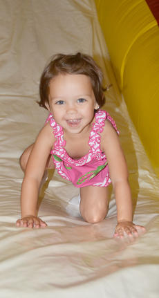 "<div class=""source"">Calen McKinney</div><div class=""image-desc"">Tylee Britton, 2, of Campbellsville, smiles as she lands at the bottom of an inflatable slide.</div><div class=""buy-pic""><a href=""http://web2.lcni5.com/cgi-bin/c2newbuyphoto.cgi?pub=085&orig=library_kid-wise_9.jpg"" target=""_new"">Buy this photo</a></div>"
