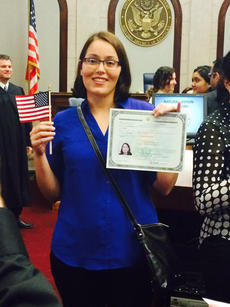 "<div class=""source""></div><div class=""image-desc"">Ticiane ""Tici"" Lucas smiles while holding an American flag and her proof of U.S. citizenship after her naturalization ceremony on June 6.</div><div class=""buy-pic""></div>"