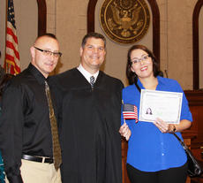 "<div class=""source""></div><div class=""image-desc"">Magistrate Judge Lanny King, left, Stephen Lucas and Ticiane ""Tici"" Lucas smile after her naturalization ceremony on June 6.</div><div class=""buy-pic""></div>"