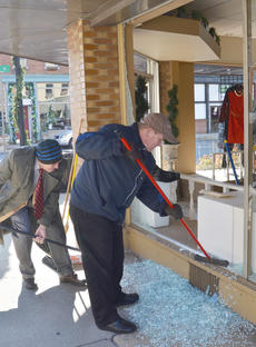 """<div class=""""source"""">Calen McKinney</div><div class=""""image-desc"""">Bill Chandler, at left, and Doug Tucker sweep glass from the shattered window.</div><div class=""""buy-pic""""><a href=""""/photo_select/49362"""">Buy this photo</a></div>"""
