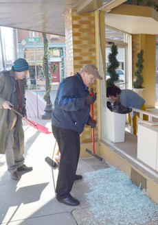 """<div class=""""source"""">Calen McKinney</div><div class=""""image-desc"""">Bill Chandler, at left, and Doug Tucker sweep glass from the shattered window. Inside cleaning glass is part-time Merle Norman employee Jamie Barber.</div><div class=""""buy-pic""""><a href=""""/photo_select/49363"""">Buy this photo</a></div>"""