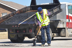 """<div class=""""source"""">Leslie Moore</div><div class=""""image-desc"""">City Street Department employee Tom Rose uses hot coal mix to fill potholes and a break in the pavement on Albion Way.</div><div class=""""buy-pic""""><a href=""""/photo_select/50557"""">Buy this photo</a></div>"""