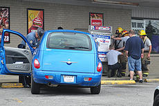 "<div class=""source"">Jeff Moreland</div><div class=""image-desc"">A vehicle reportedly crashed into a propane tank storage bin outside the Minit Mart convenience store on East Broadway Friday afternoon. No injuries were believed to have resulted from the crash. Complete details are not yet available.</div><div class=""buy-pic""><a href=""/photo_select/51860"">Buy this photo</a></div>"