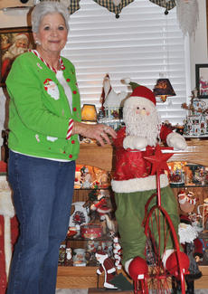 "<div class=""source"">Leslie Moore</div><div class=""image-desc"">Regnia Fair was overjoyed when she was presented with this early Christmas present of Santa Claus on a bicycle.</div><div class=""buy-pic""><a href=""http://web2.lcni5.com/cgi-bin/c2newbuyphoto.cgi?pub=085&orig=regnia_fair_4.jpg"" target=""_new"">Buy this photo</a></div>"
