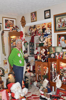 "<div class=""source"">Leslie Moore</div><div class=""image-desc"">Regnia Fair can't help but smile every time she walks into her Santa Claus room filled with about 3,000 Santa Clauses that stays up year-round.</div><div class=""buy-pic""><a href=""http://web2.lcni5.com/cgi-bin/c2newbuyphoto.cgi?pub=085&orig=regnia_fair_7.jpg"" target=""_new"">Buy this photo</a></div>"
